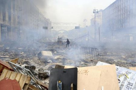 A man walks at the site of clashes between anti-government protesters with Interior Ministry and riot police in Kiev