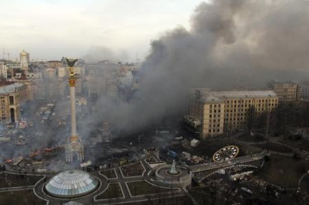 Smoke rises above Independence Square during anti-government protests in central Kiev