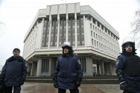 Interior Ministry members stand guard near the Crimean parliament building in Simferopol