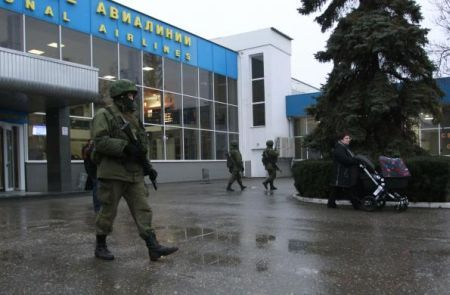 Armed men patrol at the airport in Simferopol