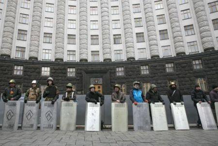 Anti-Yanukovich demonstrators guard a government building in Kiev