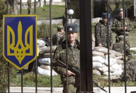 Ukrainian servicemen gather on the territory of their military unit located in the village of Lyubimovka near a local airfield
