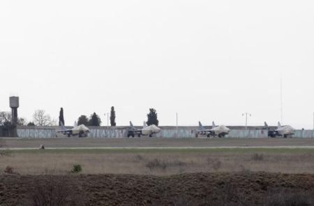 Unidentified fighter jets are seen at the Belbek Airport in the Crimea region