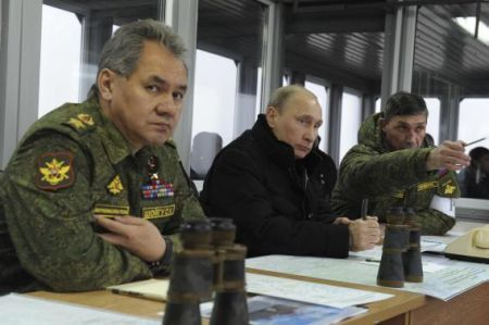 Russia's President Putin, Defence Minister Shoigu and head of Russian army's main department of combat preparation Buvaltsev watch military exercises at Kirillovsky firing ground in Leningrad region