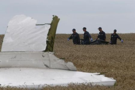Members of the Ukrainian Emergency Ministry carry a body at the crash site of Malaysia Airlines Flight MH17, near the settlement of Grabovo