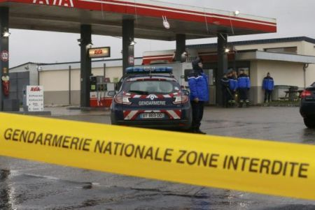 A Gendarmerie cordon is seen at a gas station in Villers-Cotterets, north-east of Paris, where armed suspects from the attack on French satirical weekly newspaper Charlie Hebdo were spotted in a car