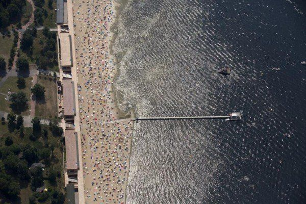 People sunbathe and swim at the beach of Wannsee near Berlin