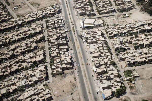 The streets and houses of Iraqi capital Baghdad are seen in this aerial picture taken from the helicopter transporting U.S. Secretary of State John Kerry