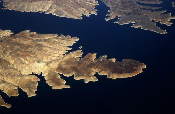 The town of Susuz is seen on the northern shore of the Ataturk dam through the window of a passenger aircraft flying over south-eastern Turkey province of Adiyaman
